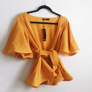 Nasty Gal Tops - Peplum Wrap Blouse